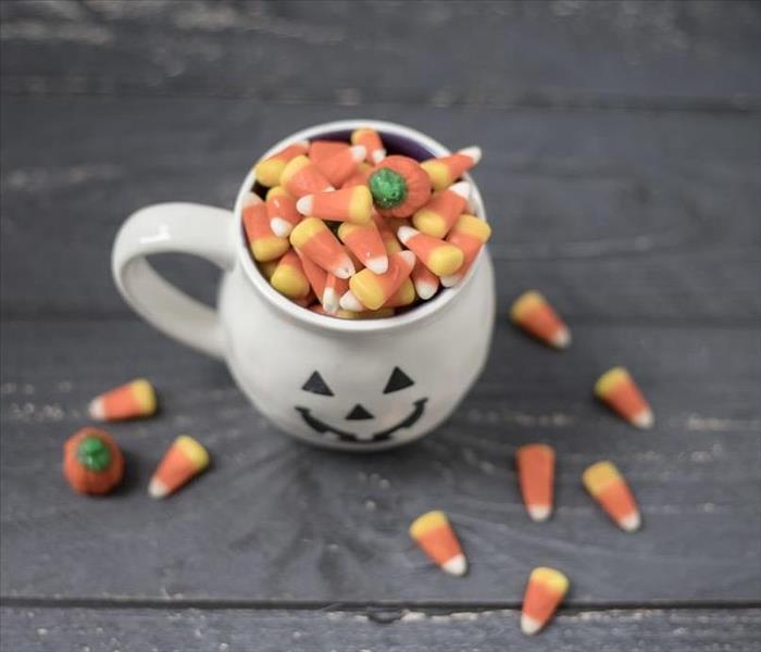 A cup with candy corn